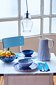 Table set for two with crockery in various blue patterns