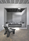 Masonry couch in niche in interior in shades of grey