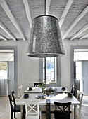 Zinc lampshade in country-house-style dining room