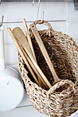 Wicker basket used to store kitchen utensils