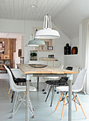 Scandinavian country-house-style dining room in shades of grey
