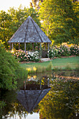 Garden pond and pavilion in a landscaped garden