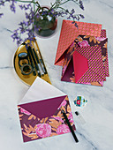 Homemade envelopes made from colourful paper