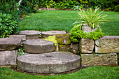 Old millstones as steps in the garden with different levels