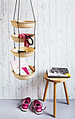 Homemade hanging shelves made from woven baskets