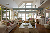 Romantic, shabby-chic living room with open ceiling structure