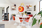 Classic Tulip table and chairs and colour-coordinated screen print in open-plan interior