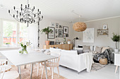 Scandinavian-style living-dining room in natural shades