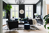 Elegant living room with black walls and black and white accessories