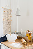 Macrame wall-hanging next to worksurface in kitchen
