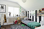 Wide stripes and graphic patterns in monochrome child's bedroom