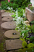 Garden path made from old millstones and sandstone slabs