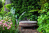 Old millstone as a decorative object in the garden