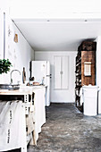 Vintage kitchen in white with pigeon stable converted into a storage shelf