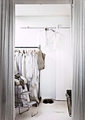 Dressing room in white separated by floor-to-ceiling curtains