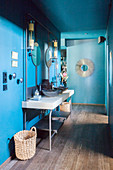 Washstand with twin sinks against blue wall in hall