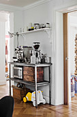 Kitchen utensils and cut-glass carafe on console table