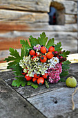 Autumn Bouquet With Rose Hips, Hydrangea And Stonecrop In Leaf Cuff