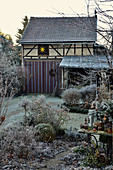 Wintry garden with barn in background