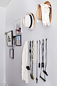 Fashion accessories and photo gallery on white wall
