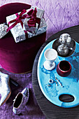 Gifts and Christmas decorations in silver, turquoise and violet