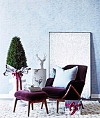 Purple velvet armchair with ottoman and Christmas decoration