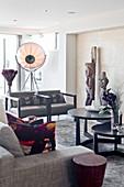 Grey sofa set, round tables, artworks and studio lamp