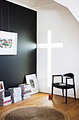 Light falls through the cross-shaped wall opening