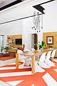 Designer chairs at the dining table in the open living room