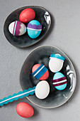 Easter eggs decorated with paper trims