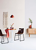 Minimalist dining room in delicate shades of red