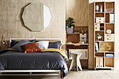 Plywood clad walls in the bedroom with home office