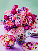 Bouquet of pink spring flowers with tulips, hyacinths and ranunculus