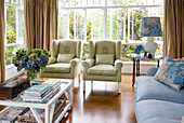 Upholstered seating in blue and green in classic living room