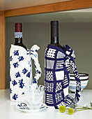 Bottles wrapped in patterned blue-and-white fabric