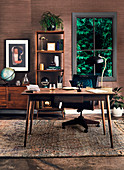 Desk, sideboard and open shelf in the study with dark wood paneling