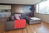 Leather sofa set with ottoman in minimalist interior