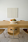 Pale wooden dining table and chairs
