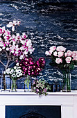 Flower decoration with magnolias and roses in gals vases