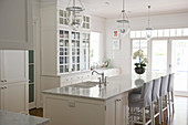 Bright, white country-house kitchen