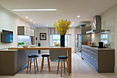 Modern kitchen with breakfast bar and stools