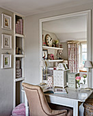 Leather chair at wooden desk with large mirror in girl's room