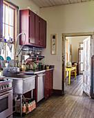 Falu-red cupboards in vintage kitchen