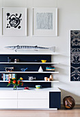 Decoration on a white shelf with a black back wall in the living room