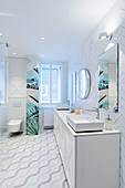 Tiles laid in herringbone pattern in white bathroom