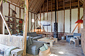 Living room in converted barn with timber frame