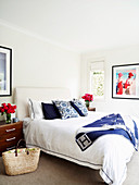 Bright bedroom with blue and red accents