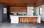 Modern open kitchen with wooden fronts and kitchen island