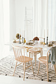 Table set for autumn dinner in bright interior