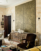 Large double panel painting with cross hatch pattern above table draped with oriental carpet